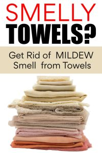 pile of fresh towels with text box on how to get rid of smelly towels