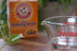 pyrex measuring cup and box of baking soda to help get rid of mildew smells in towels