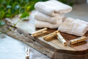 wooden board with folded towels and clothes pins as fresh air is one of the best solutions for bad smelling towels