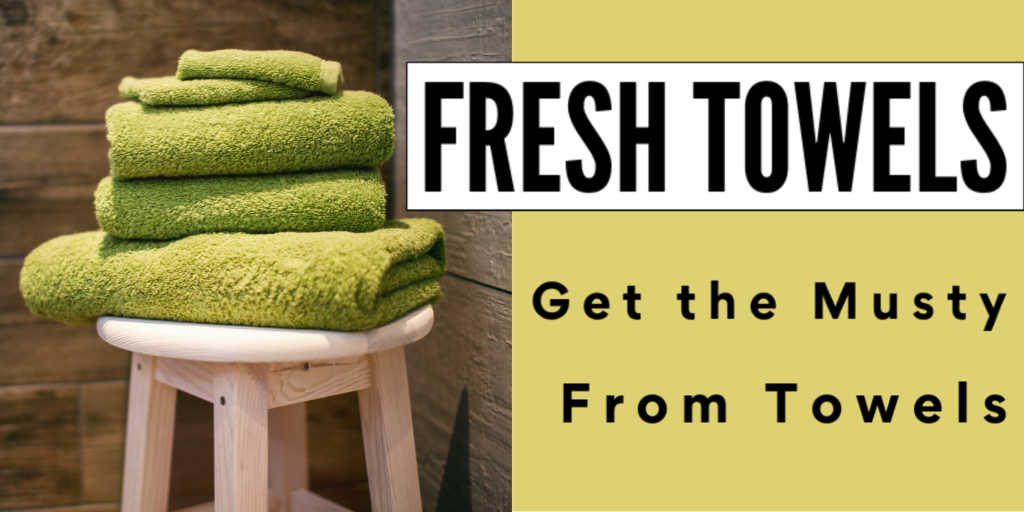 pile of green towels on a wooden stool with text box on how to get rid of musty smell