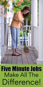 woman sweeping a covered front porch