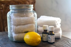 ingredients for reusable wipes including lemon and cloth rages in a glass jar