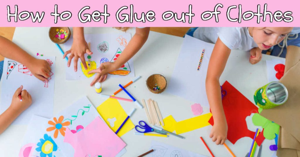 top down view of kids painting, drawing and gluing on a colorful art project