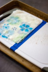 Wet a paper towel and lay it over the leaning mixture to keep it wet while it works