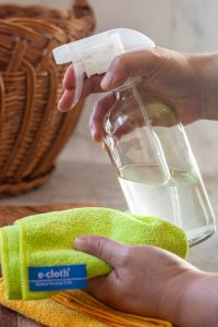 using an e-cloth with the homemade disinfecting solution in a glass spray bottle