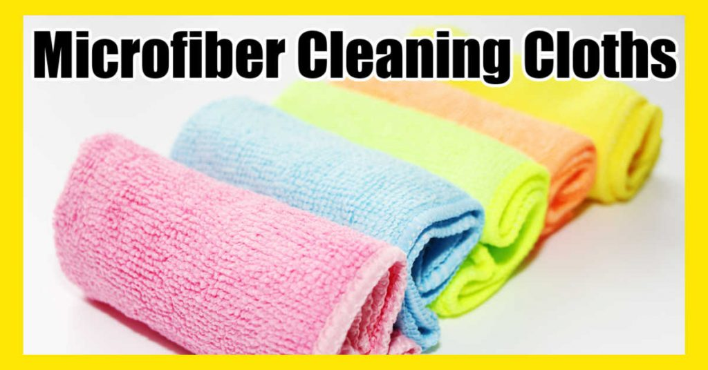 several colorful microfiber cleaning cloths rolled up in a row
